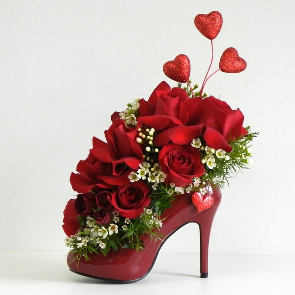 red flowers arrangement in shoe for girl 15