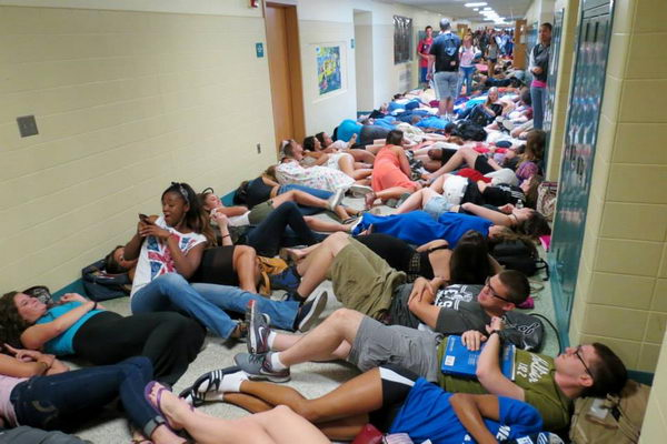 9 sleep in the hallway
