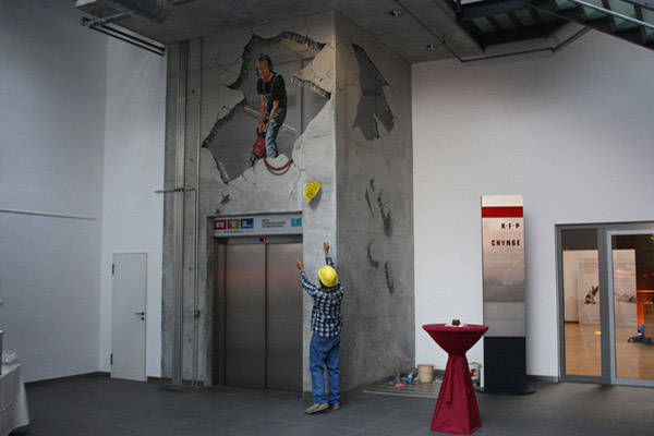 3D Street Art Treuhaus   Frankfurt. A real estate company was celebrating 25th anniversary of their object. The 3D artist worked on concrete in the atrium.