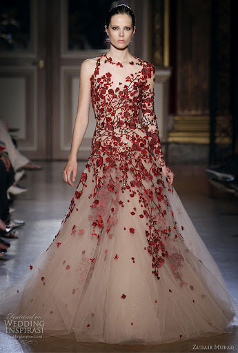 Traditional Chinese Wedding Dress by Zuhair Murad. The red wedding dress is favorite for all Chinese people because red is considered as good luck that can keep evil spirits away.
