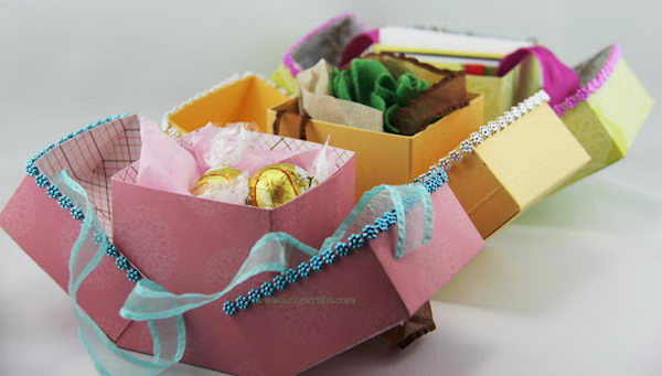 DIY Cube Favor Boxes. This Handmade Gift Favor Box is very unique because it opens both ways while the box stays in the middle.