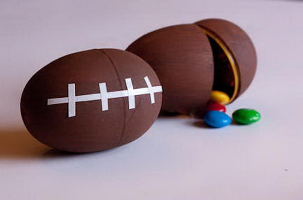 Football Shaped andy Containers. These easy to make football shaped favor boxes are perfect for super bowl themed snacks.
