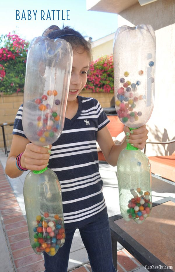 Baby Rattle as a 15 Minute to Win It Party Game. Player must shake gumballs from an empty 2-liter bottle into the other bottle on the bottom.
