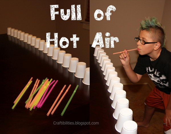 Pushing Cup Game as a 15 Minute to Win It Party Game. Push the cup by blowing into the straw to move them across a line on the table.