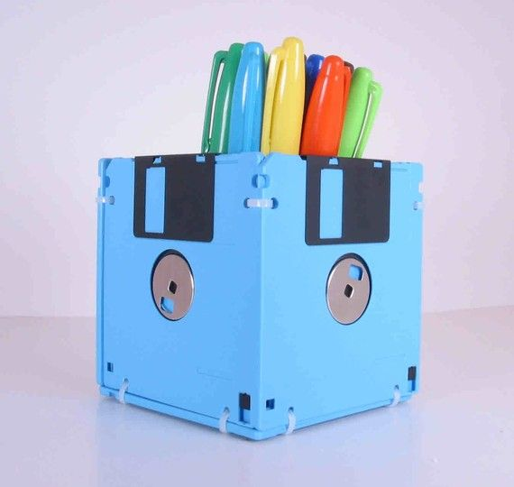 Floppy Disk Pen and Pencil Holder. This item is manufactured out of sky blue recycled floppy disks. A perfect gift for a co worker or that special geek in your life.