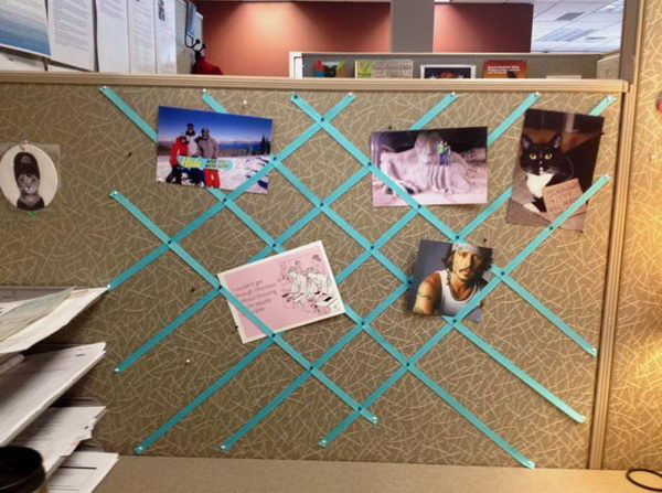 You can pin ribbon to the wall of the cubicle for a decorative photo collage.