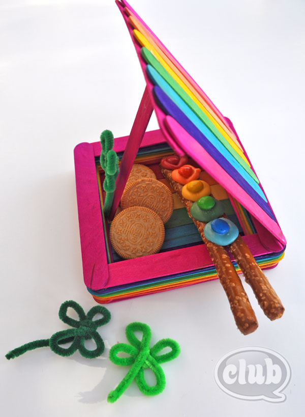 This Leprechaun trap built with rainbow colored popsicle sticks is so cute.