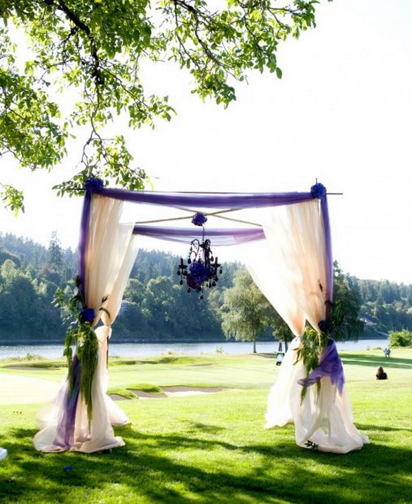 Purple Chuppah With Hanging Chandlier.