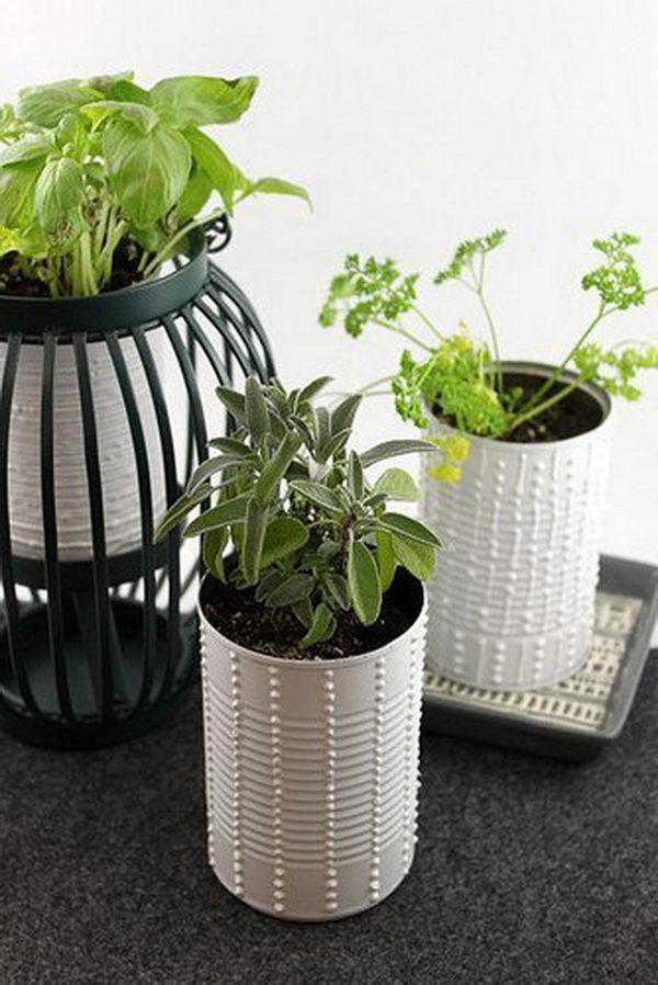 Upcycled Herb Cans as DIY Planters.
