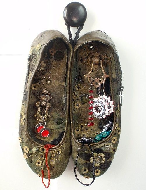 Vintage Shoes on Wall. The old shoes were decorated, sewn together and hung on the wall for storing jewelry or displaying unusual items.