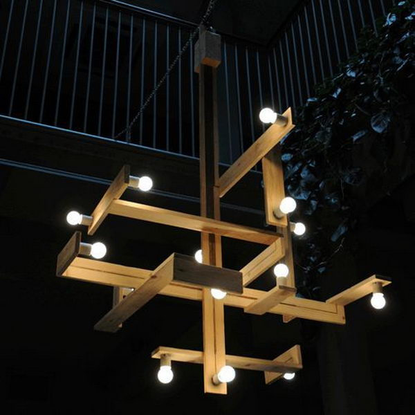 Wood Pallets Chandelier. The pallet was cut, different sizes of pieces were selected, and they were put together and secured n a very artistic way. The result was a very unique and functional chandelier.