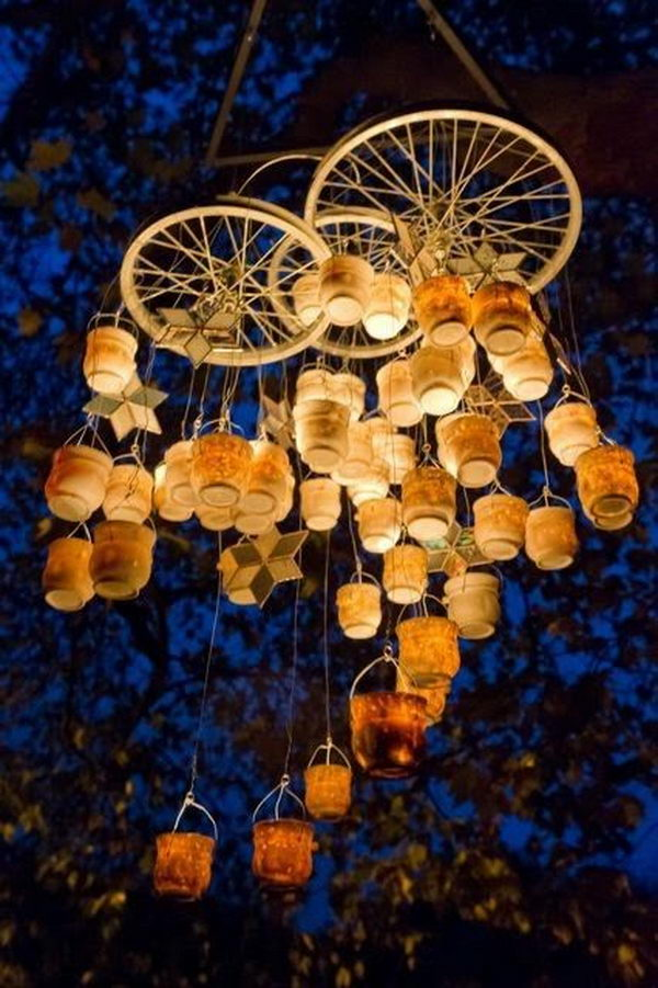 Bottle Chandelier. It's cool to use wire, candles, jars and bicycle spokes to create a gorgeous bottle chandelier for your backyard.