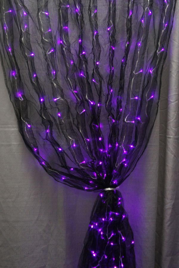 LED light Curtain. Black fabric sash and purple LED lights together makes for one really cool curatin decoration.