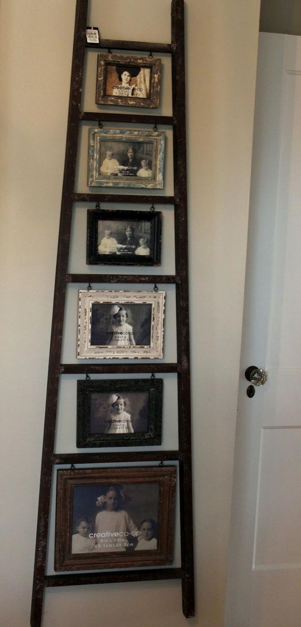Old Ladder Photo Display. Turn an old ladder into a creative photo display with hanging frames.