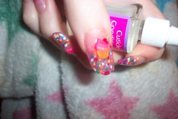 3D Cupcake Nail Art, 3D nail art is a technique for decorating nails that creates three dimensional designs.