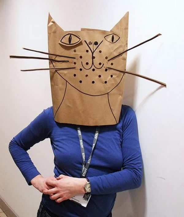 Cat Paper Bag Costume. There is no easier costume than a paper bag mask. Grab a paper bag and cut out holes for your eyes then grab a few markers and let your imagination go wild. They are so simple for kids to make and to wear.