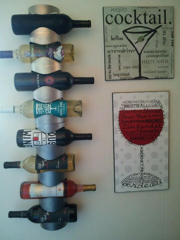 DIY Wall Mounted Wine Rack Idea. Really fun to create and have an aesthetic appeal that applies to your unique home.