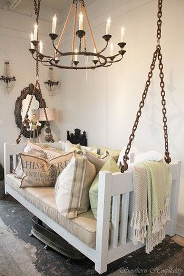 Repurposed crib into porch swing.