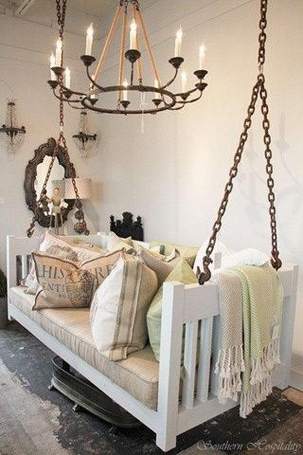 Repurposed crib into porch swing.