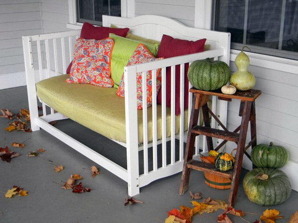 Baby crib repurposed front porch daybed.
