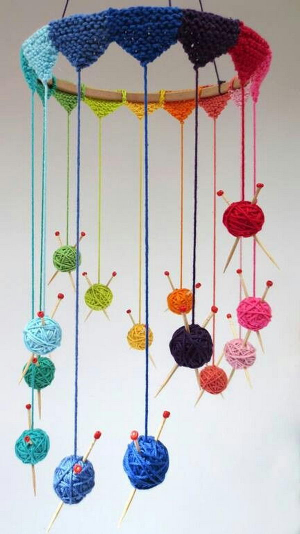 Knit some tiny bunting to go round a wooden hoop and suspend all the little balls. The wind chine craft requires minimal knitting but is a fun project to start off with.