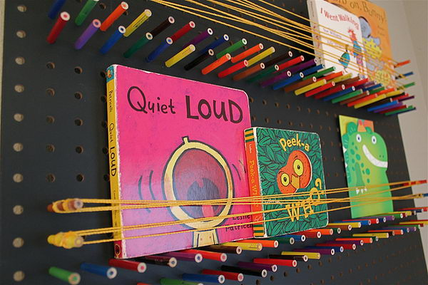 Pegboard Bookshelf with Pencils and String. Creatively organized home office boosts your mood and make you more productive.