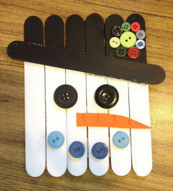 Snowman from sticks and buttons. Add charm to any Christmas tree or gift box, and make charming and thoughtful holiday presents for friends and family members.