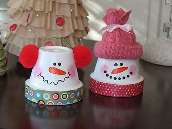DIY snowmen from terra cotta oots. Add charm to any Christmas tree or gift box, and make charming and thoughtful holiday presents for friends and family members.