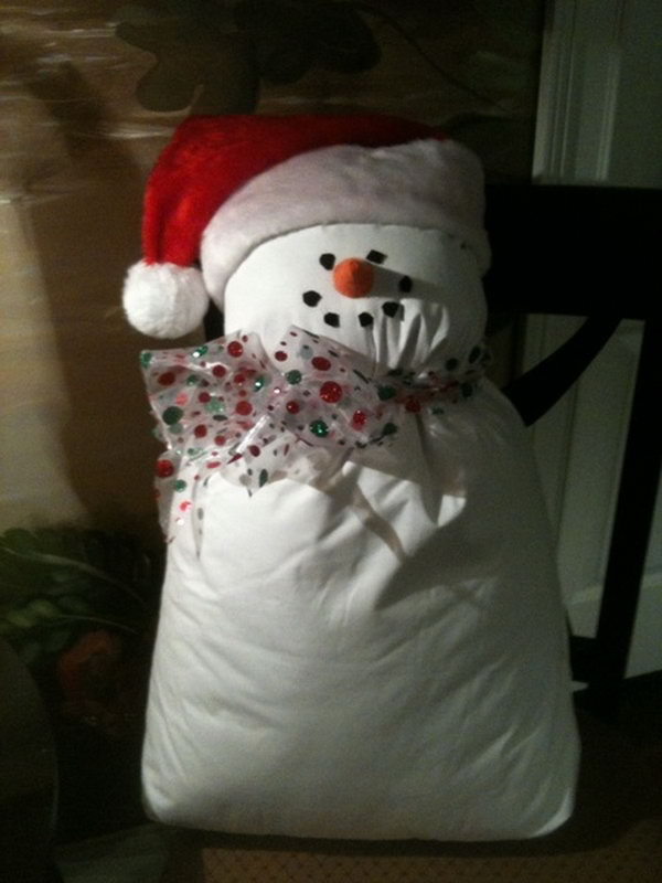 Snowman from bed pillow and a santa hat. Add charm to any Christmas tree or gift box, and make charming and thoughtful holiday presents for friends and family members.