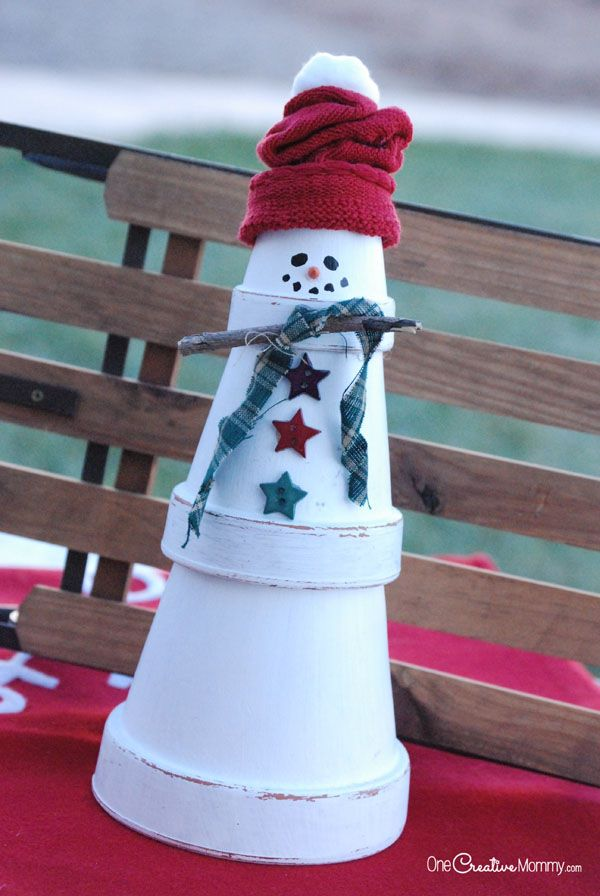Terra cotta snowman craft. Add charm to any Christmas tree or gift box, and make charming and thoughtful holiday presents for friends and family members.