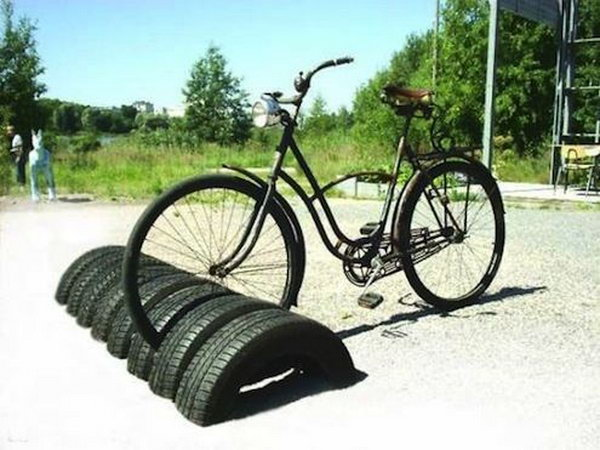 Reuse tires as bike storage.