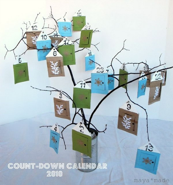24 little houses are hung from a bouquet of bare winter branches as a advent calendar. This advent calendar is a fun, popular way for kids and adults to count down the days until Christmas. Kids would love the surprises hidden behind each day.