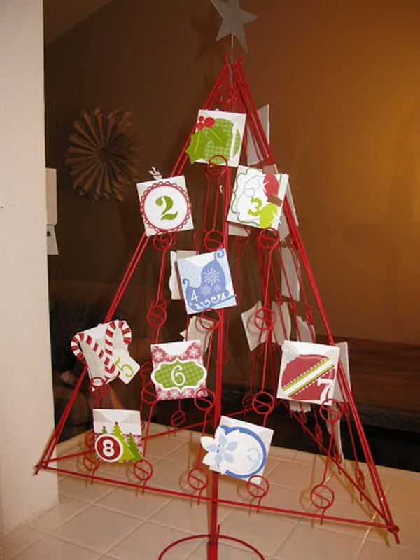 Use a red wire christmas tree as advent calendar. This advent calendar is a fun, popular way for kids and adults to count down the days until Christmas. Kids would love the surprises hidden behind each day.