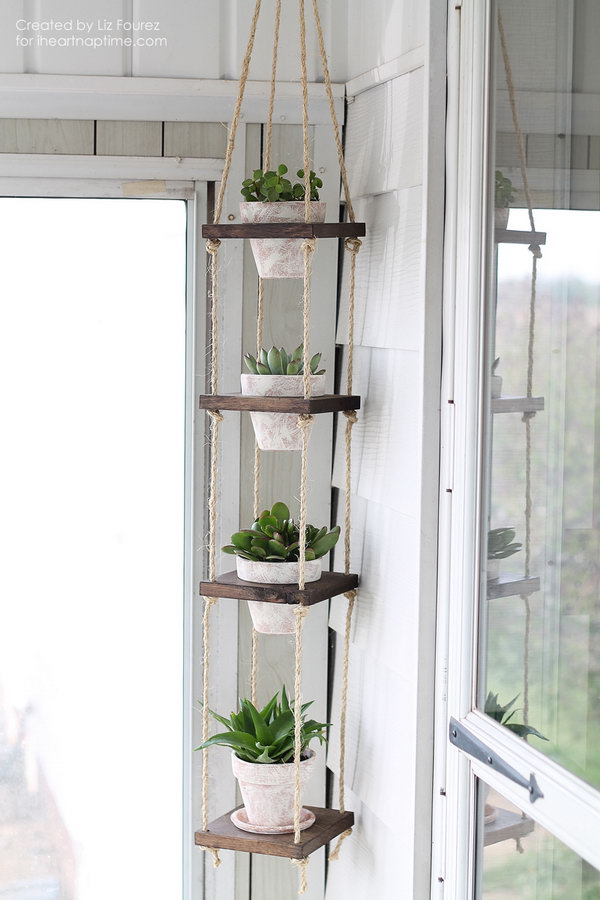 DIY Vertical Plant Hanger tutorial. This project makes a beautiful display for your potted plants without taking up a ton of room. Perfect for small balcony garden.