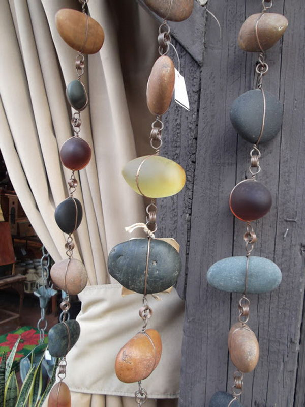 Creative Rain Chains. Not only make a good sound and enhance your house exterior appearance, but also divert water away from your house.