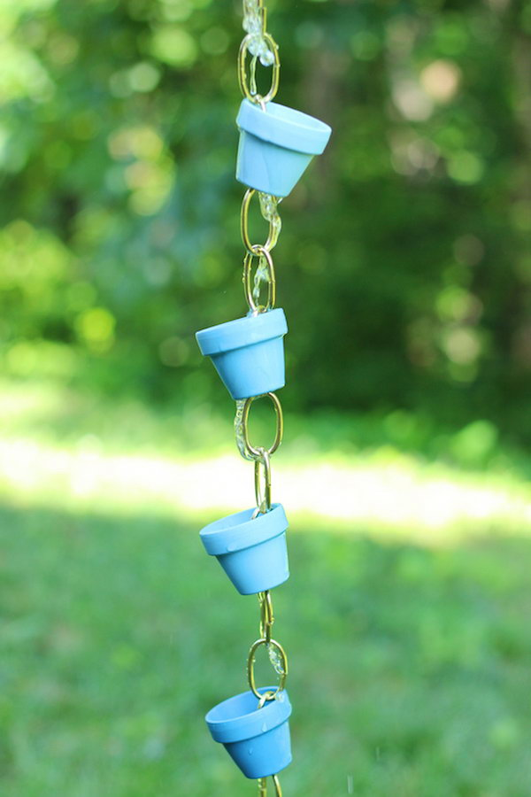 This DIY rain chain is made from small terra cotta pots   inexpensive, easy, and adorable!