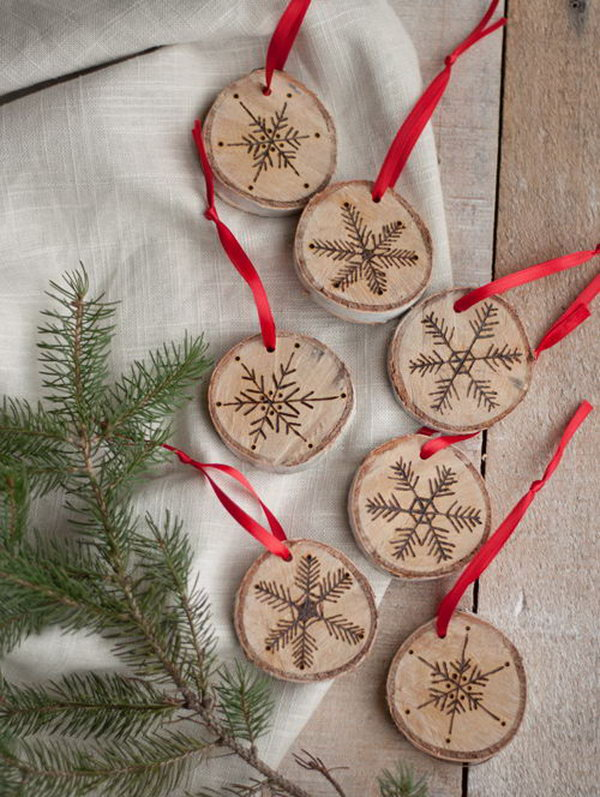 These little wood burned snowflake ornaments will instantly give your home a rustic, woodsy, holiday feel, and have you ready to greet the first snowfall with a big grin.