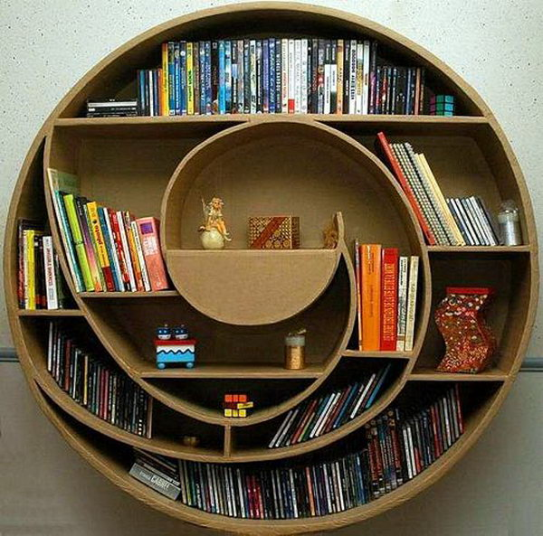 This circular cardboard shelf not only provides space for your movie DVDS and books, but also enhance your house interior design.