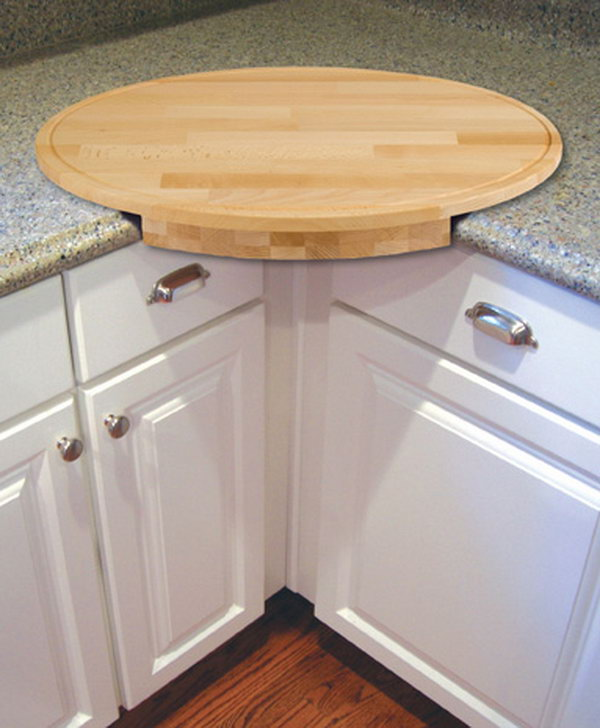 this oval cutting board extends your countertop a little extra and a little extra storage - Kitchen Countertop Storage Ideas