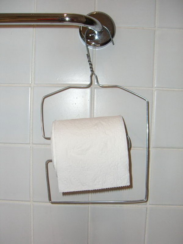 This wire clothes hanger was upcycled into a toilet paper holder.