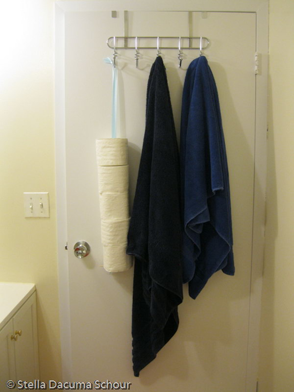 Hang your toilet paper rolls behind the bathroom door for extra space and out of sight.