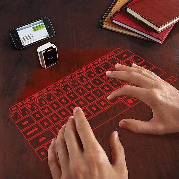 Virtual Keyboard From Brookstone. If you need a keyboard, this is the easiest carry-along one. The laser projection keyboard can turn every surface into such a cool keyboard. Your desk is your keyboard! Could you ever image this before?