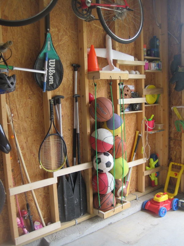 Storage Between the Studs. Utilize the space between the studs to keep things organized. A few bungee cords hung on studs gives you a great place to store all sorts of sports equipment.
