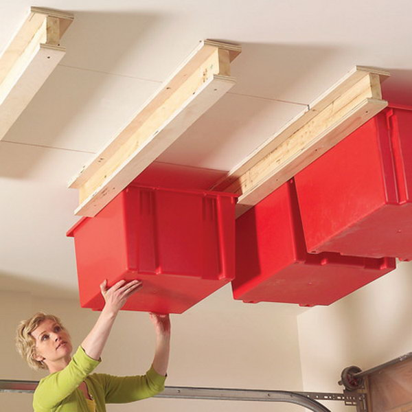 Sliding Storage on Garage Ceiling. Grab your plastic pins and build a simple system for hanging them in the garage. Get all that stuff up and out of the way and into unclaimed space near your garage ceiling.