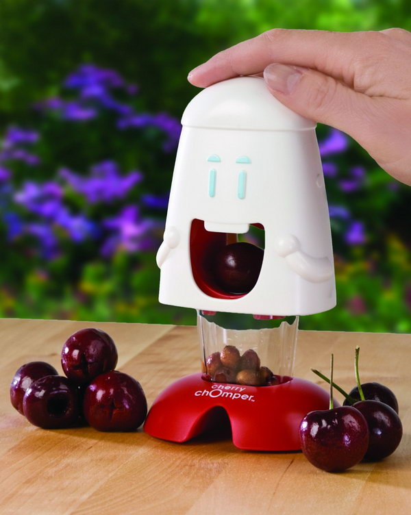 Cherry Pitter. Just place a cherry in his mouth and push down on his head, the plunger pushes the pit and juice down into a container below, leaving behind the pure fruit that can be used in desserts, salads and more.