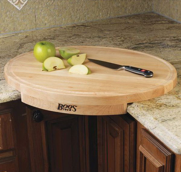 John Boos Corner Cutting Board. This oval shaped maple wood cutting board converts a counter corner space into efficient working space.