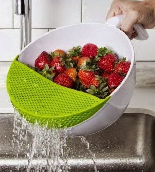 Soak and Strain Washing Bowl. A cool kitchen product which allows you to wash your fresh fruits and drain them easily without having most of them fall into the sink.
