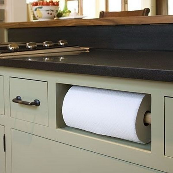 Remove your fake drawer in sink cabinet and turn it into a paper towel holder.