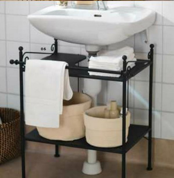 wall mounted sink it squeezes estra storage out of a small bathroom