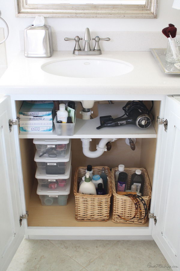 Add a shelf that was cut out for pipes in the cabinet  Use storage space. Creative Under Sink Storage Ideas   IdeaStand